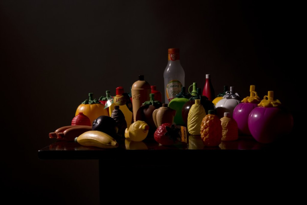 Still life of plastic containers with dark backdrop