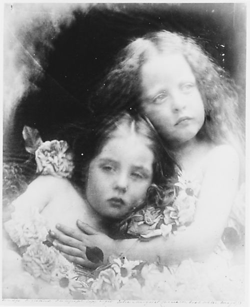 B&W photograph of two young girls looking angelic