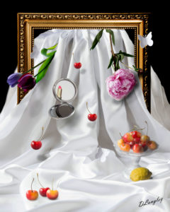 A gilt frame against a blackbackground with a white cloth flowing through and diferent objects on it
