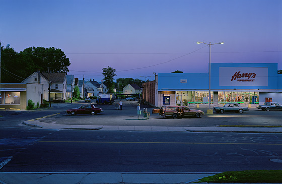 Twilight scene of an American Supermarket with a figure pushing a trolley