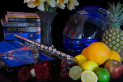 Objects arranged in Vanitas still life tradition - fruit, as skull, dead flowers and books